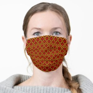 Room237 face mask orange retro 1970s abstract pattern worn by woman