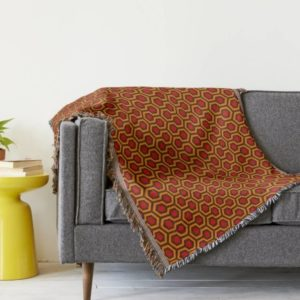 Room237 throw blanket orange retro 1970s abstract pattern lifestyle couch