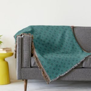 Room237 throw blanket teal retro 1970s abstract pattern lifestyle couch