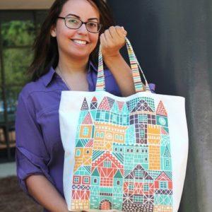 dennisthebadger tote bag with girl